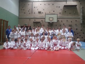 Judo 30th Anniversary celebration group with certificates and trophies